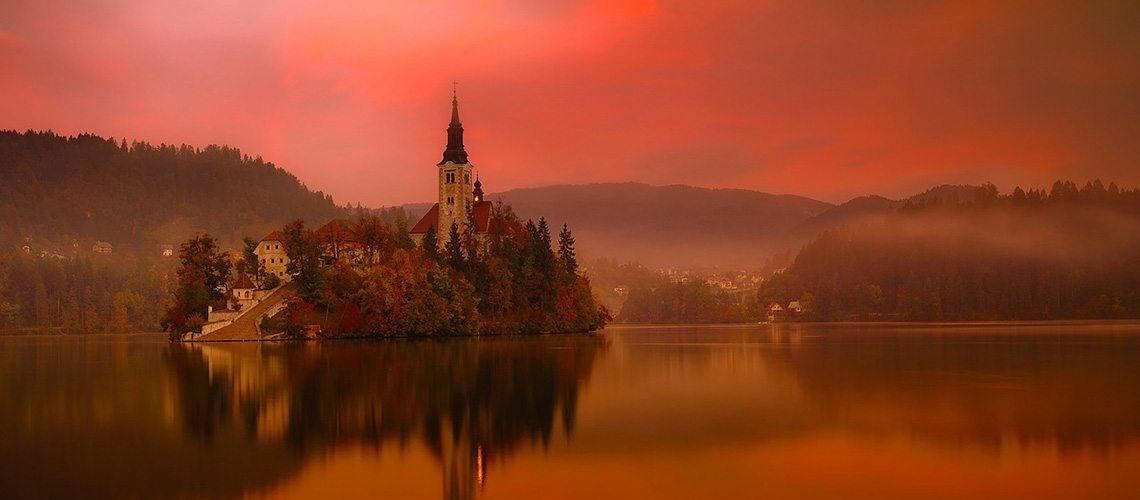 View of Lake Bled island in orange light